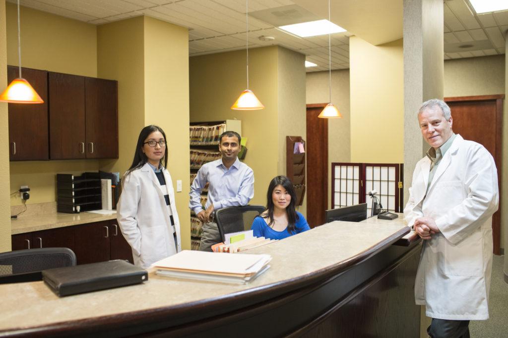 Werknemers in een tandartspraktijk ALARA werken met röntgenstraling